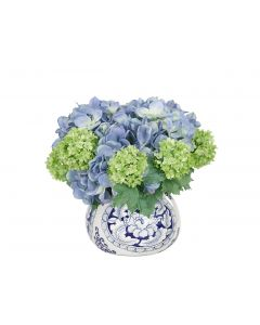 Blue and Green Hydrangea Snowball Arrangement in Blue and White Ceramic Vase